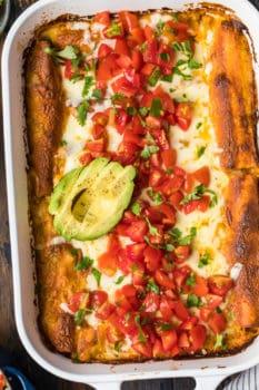 chicken enchiladas topped with avocado