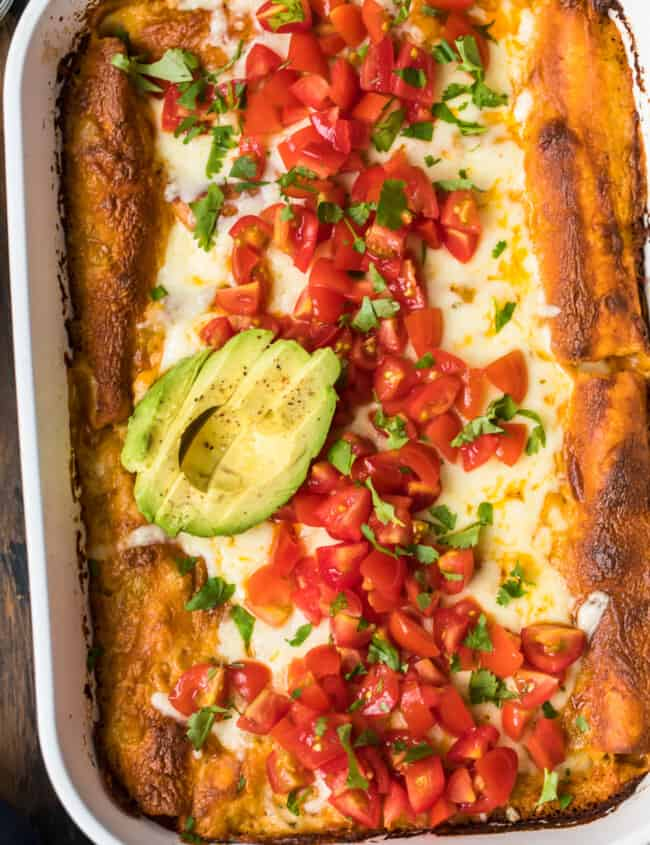 chicken enchiladas topped with avocado