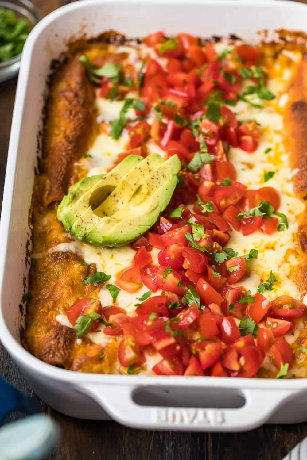 avocado on top of creamy chicken enchiladas