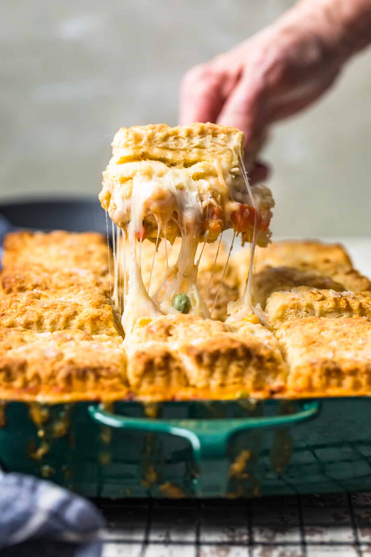 chicken pot pie being pulled out of baking dish