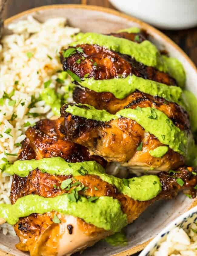 peruvian chicken with green sauce on plate