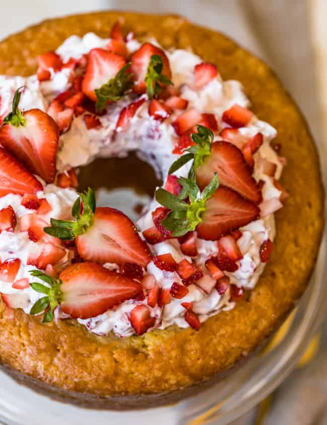 butter cake and strawberries and cream on a cake plate