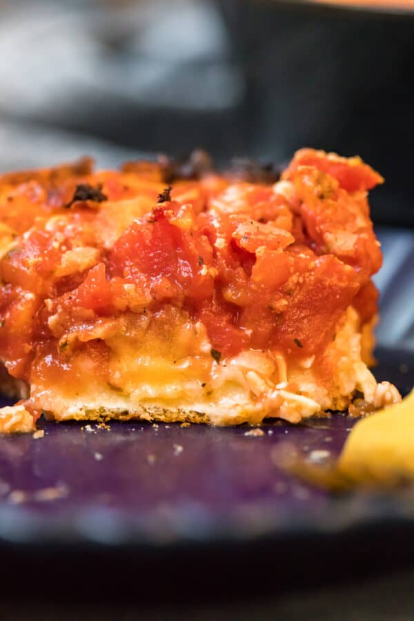 Close up of a slice of chicago deep dish pizza