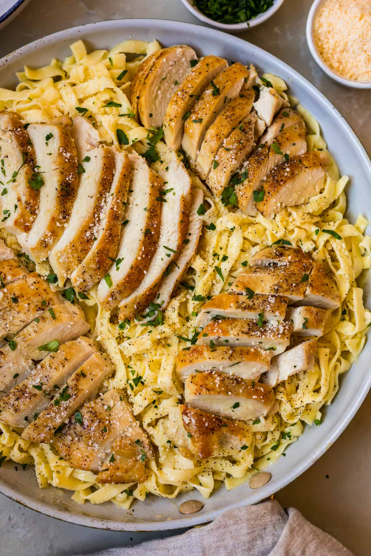 Chicken alfredo in a skillet ready to serve
