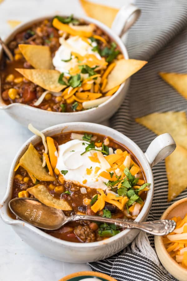 Taco soup served in two white bowls