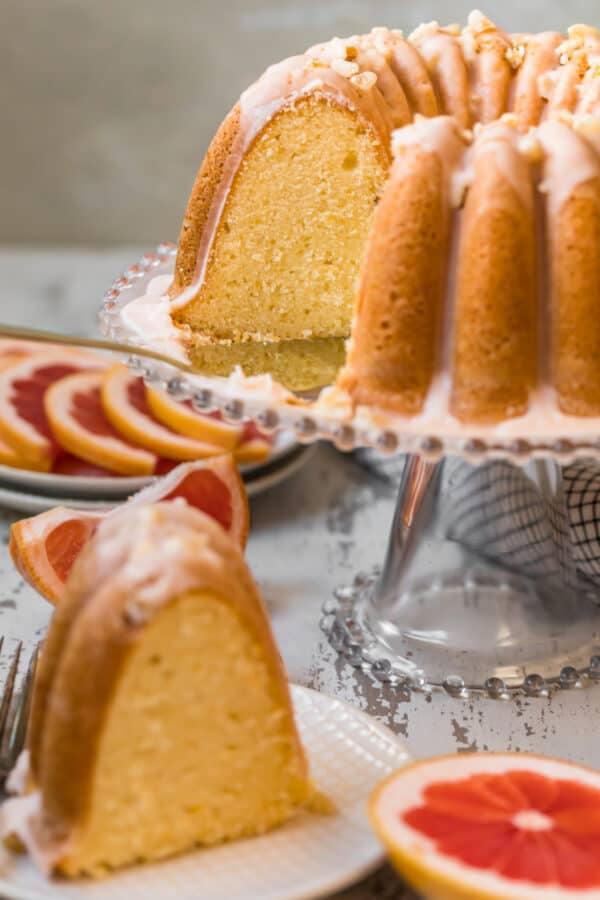 grapefruit cake with slice taken out