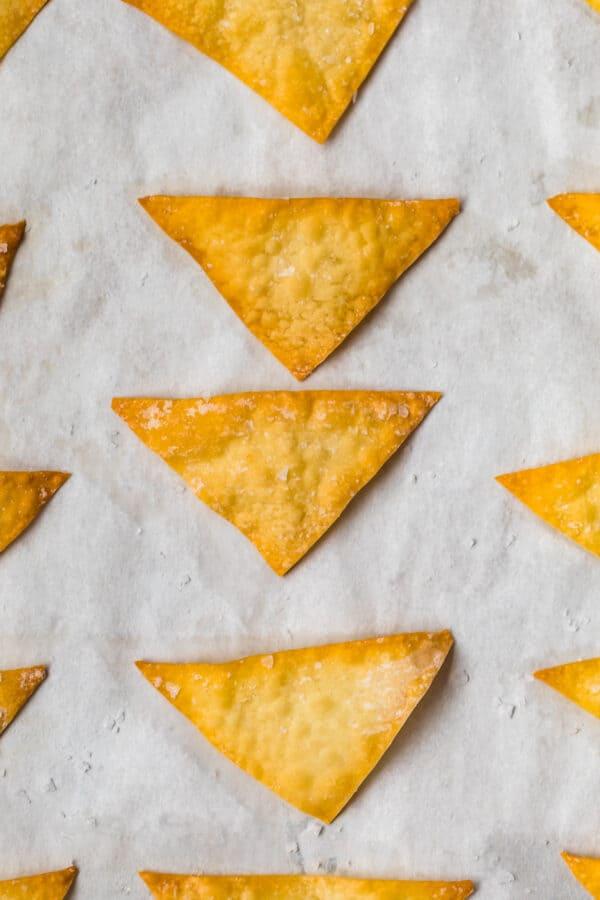 Close up of baked wonton chips on a baking sheet