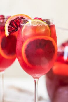 non alcoholic sangria in a wine glass with citrus garnishes