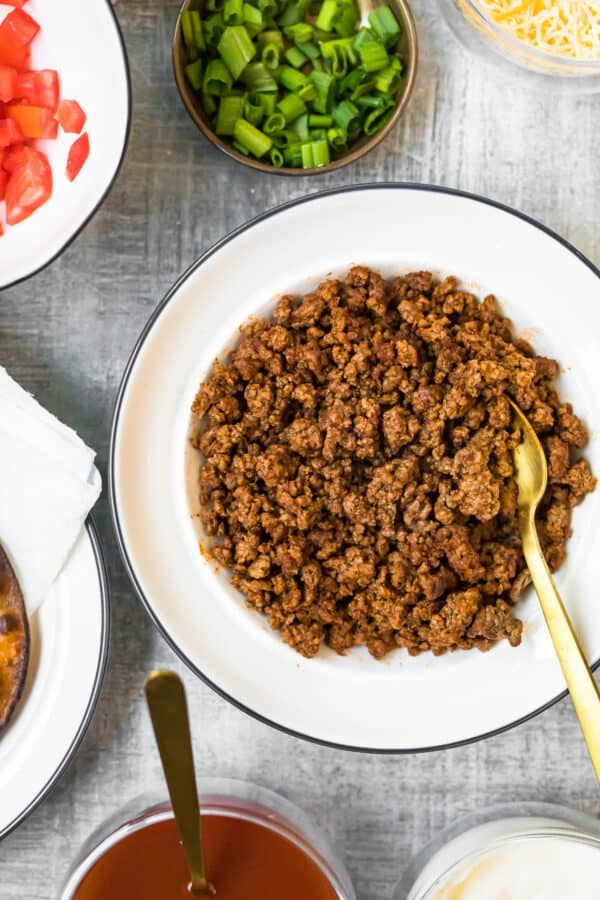 cooked ground beef in white bowl