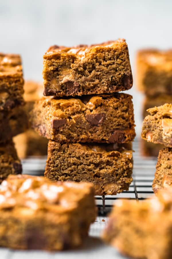 stacked chocolate peanut butter blondies on baking rack