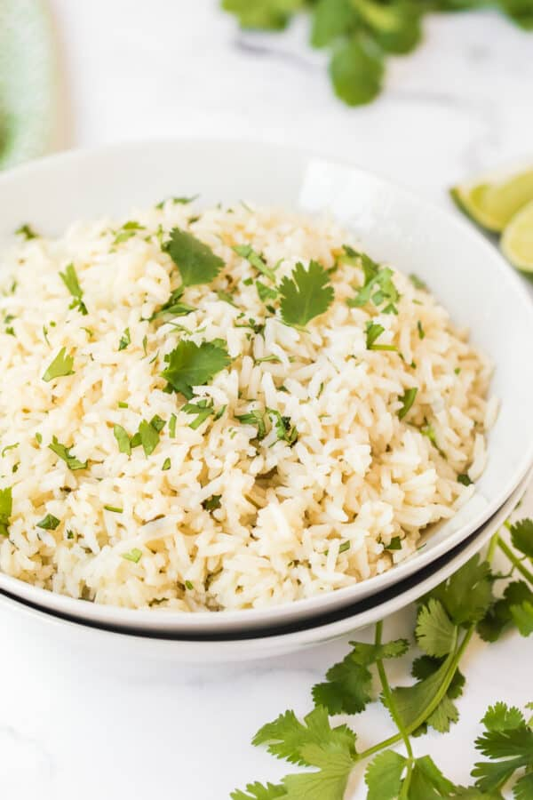 side image of cilantro lime rice in white bowl