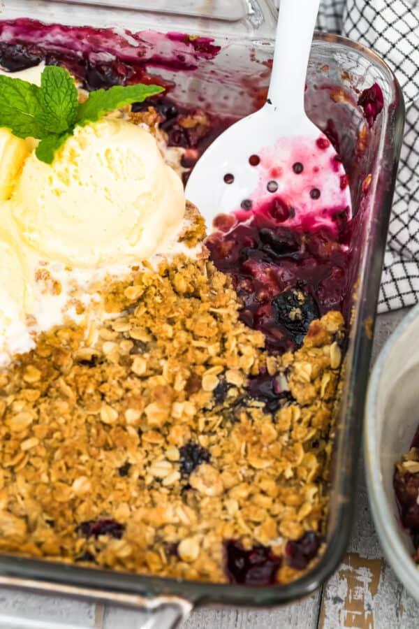 spoon in double berry crisp with ice cream