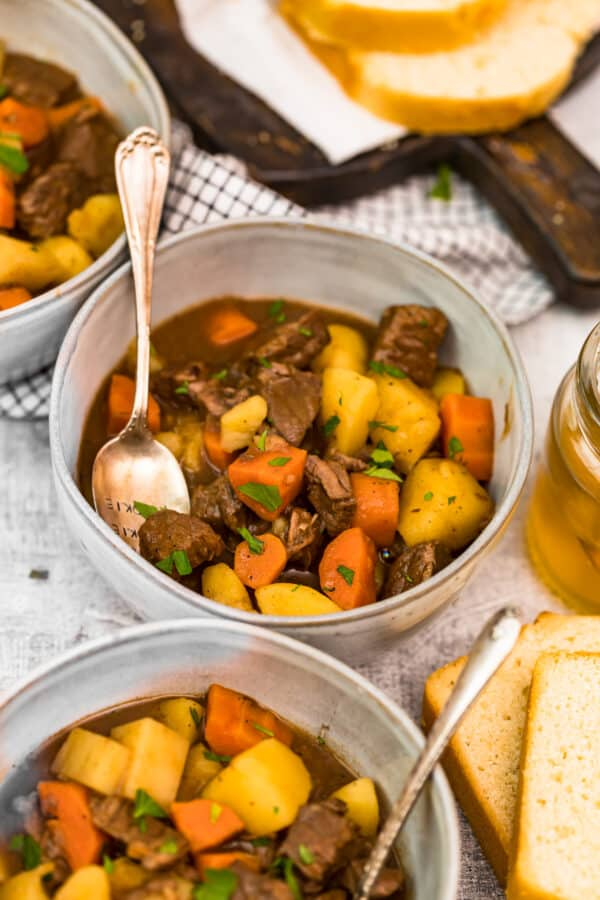 bowls of stew with beer bread