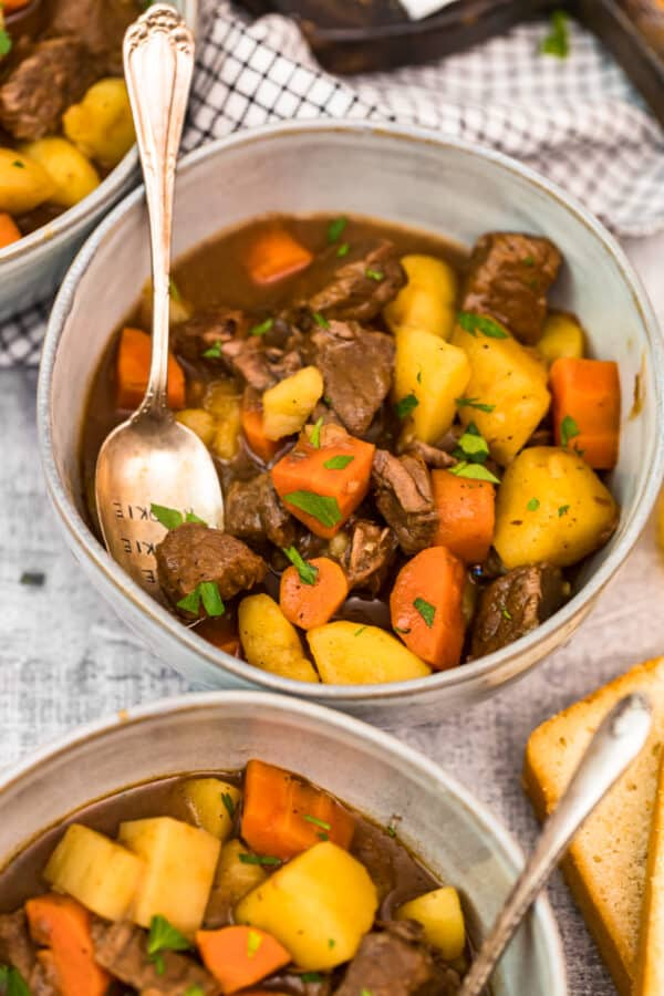 up close bowl of beef stew with spoon