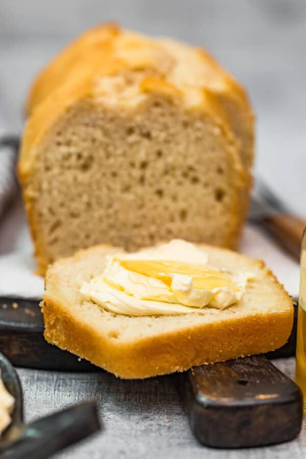 butter on slice of loaf