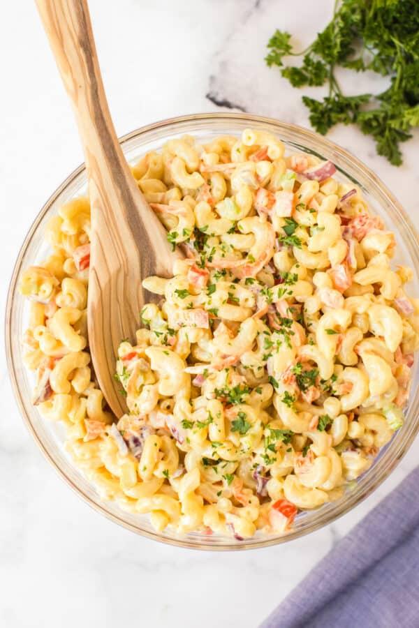 overhead image of macaroni salad with wooden spoon