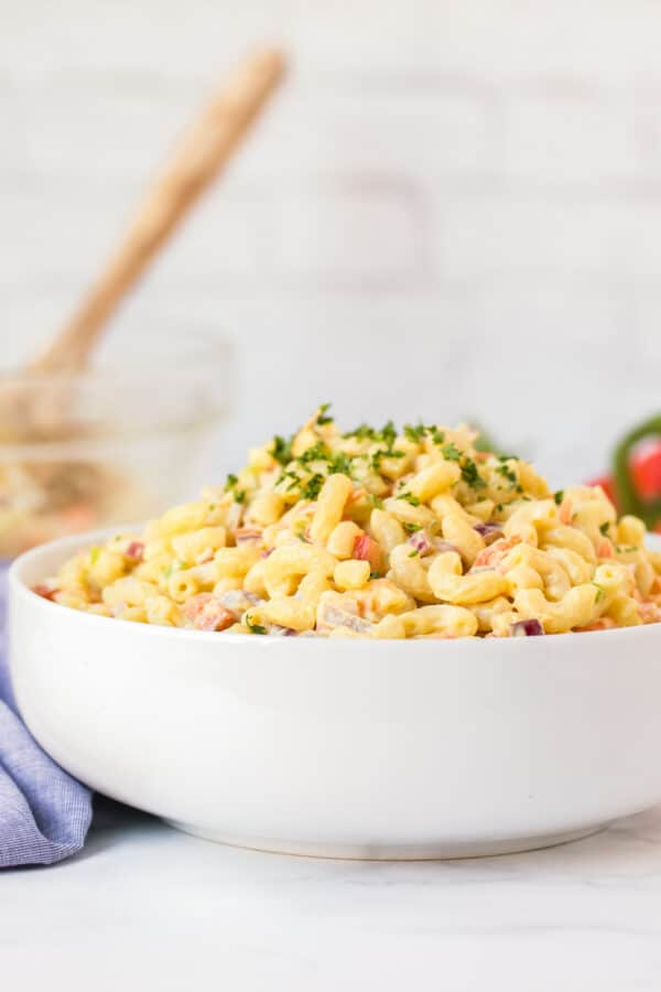 side image of macaroni salad in white bowl