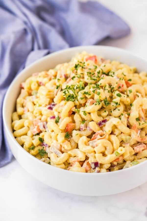 side image of macaroni salad in white bowl