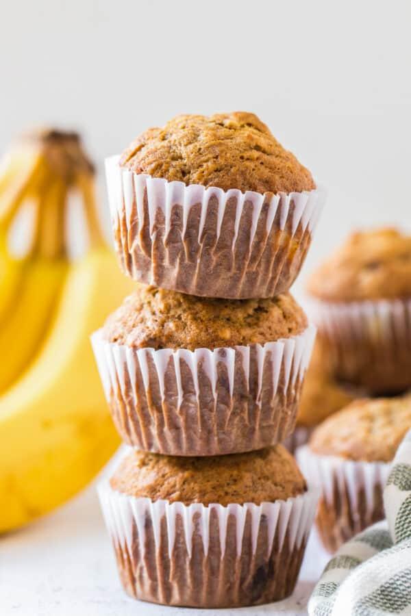 three banana muffins stacked