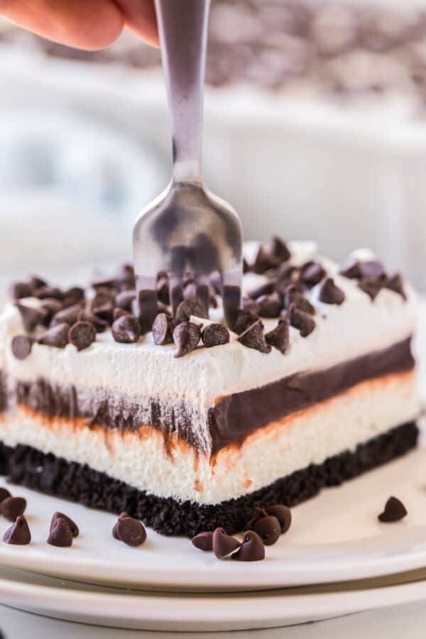 fork going down into chocolate lasagna