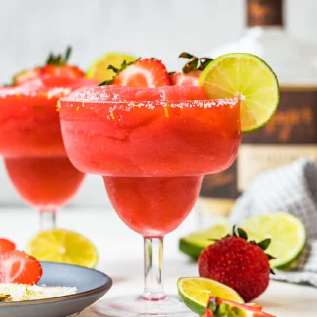 two strawberry margaritas in glasses