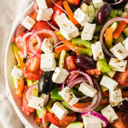 up close image of greek salad in bowl