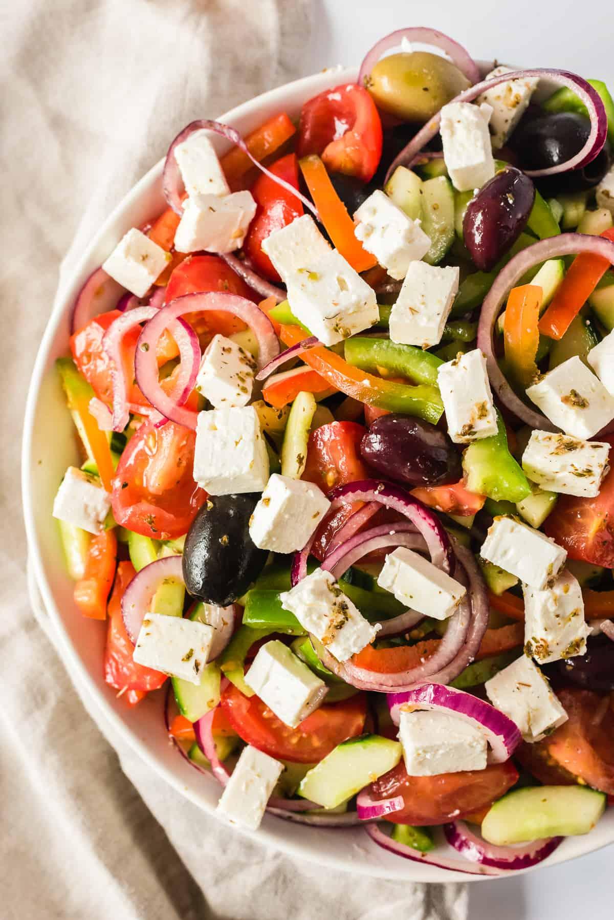 up close image of greek salad in bowl