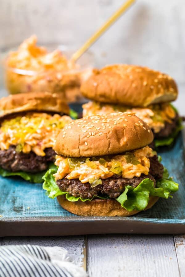 pimento cheeseburgers on blue platter
