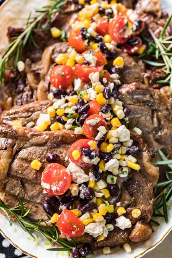 sweet tea marinated steaks topped with corn salad