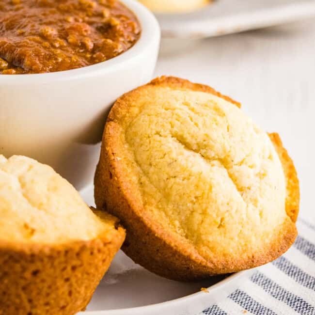 cornbread muffins next to bowl of chili