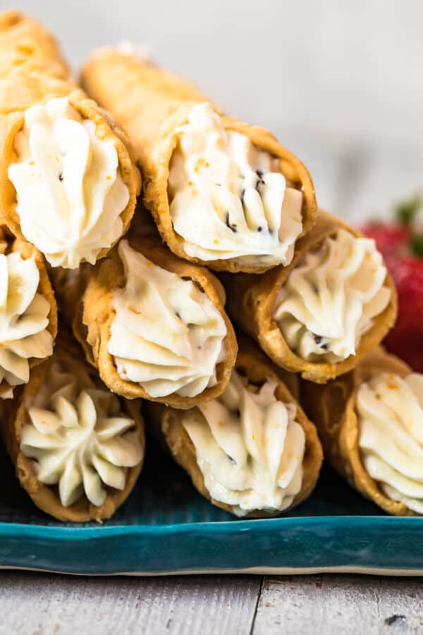 up close image of cannolis with cream