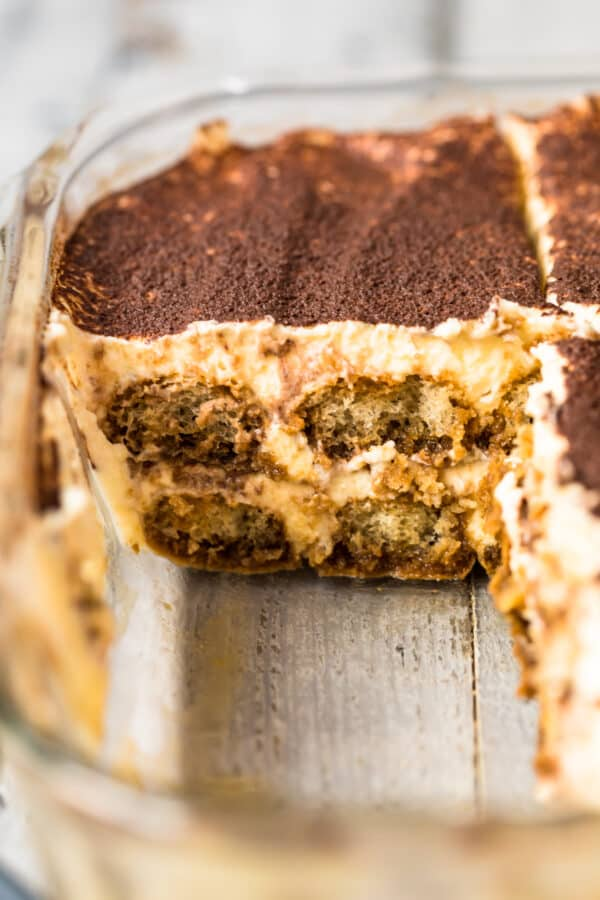 tiramisu in dish with slices cut out