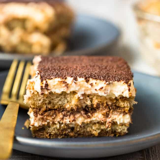 slice of tiramisu on black plate
