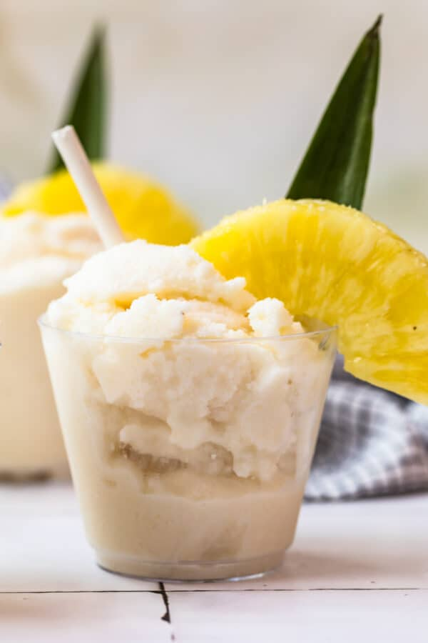 frozen pina coladas garnished with pineapple
