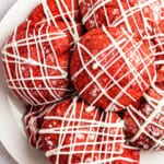platter of stuffed red velvet cookies drizzled with white chocolate