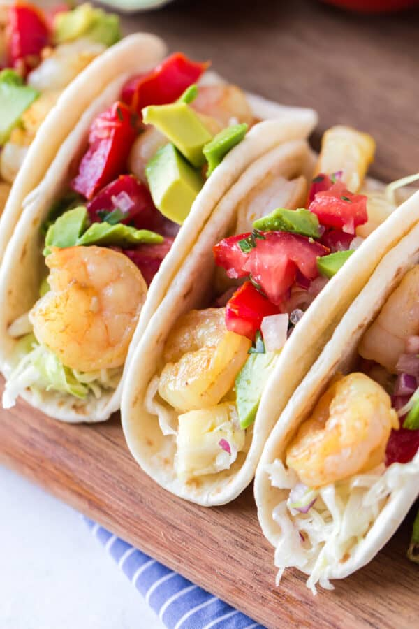shrimp tacos garnished with pineapple slaw
