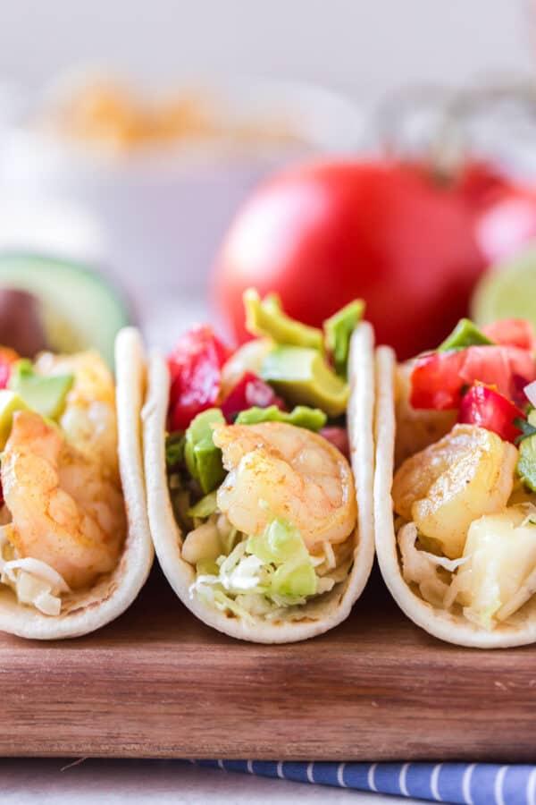 soft shrimp tacos on cutting board
