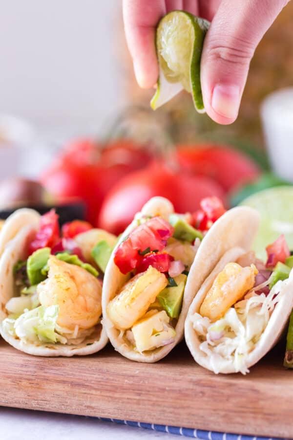 garnishing shrimp taco with lime juice