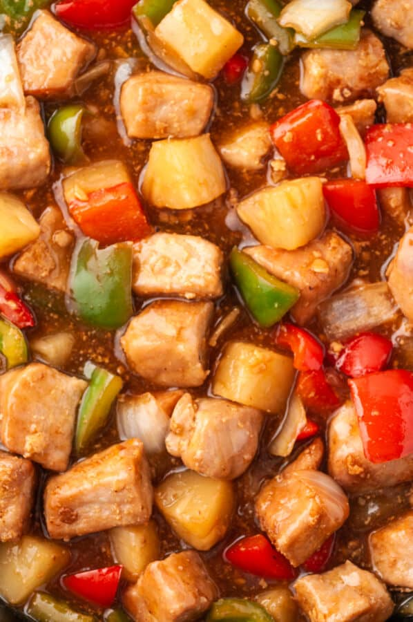 up close image of sweet and sour pork in sauce