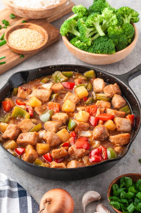 side image of skillet with sweet and sour pork with sauce