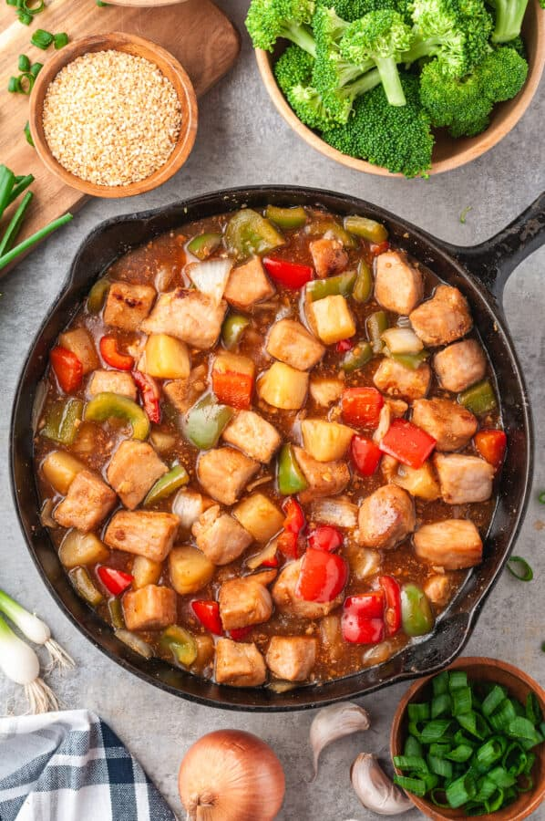 skillet filled with sweet and sour pork