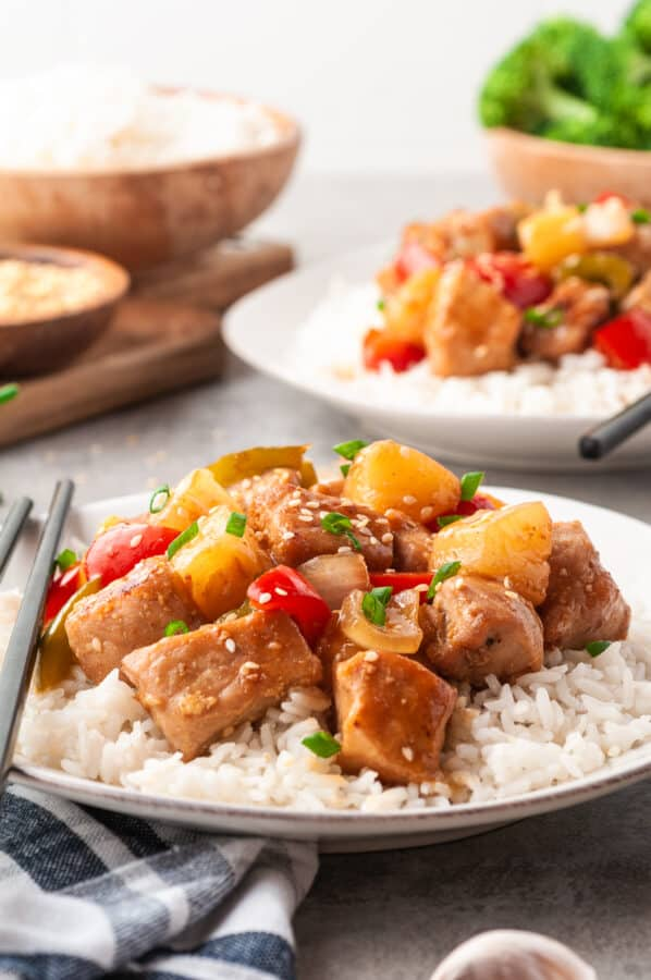 sweet & sour pork on plate over rice