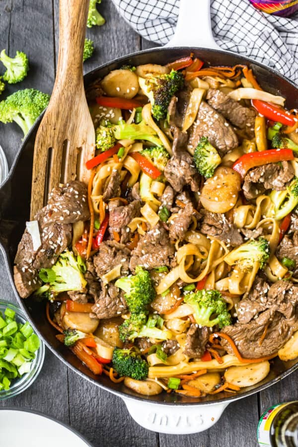 beef lo mein in white skillet