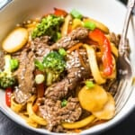 beef lo mein in white bowl