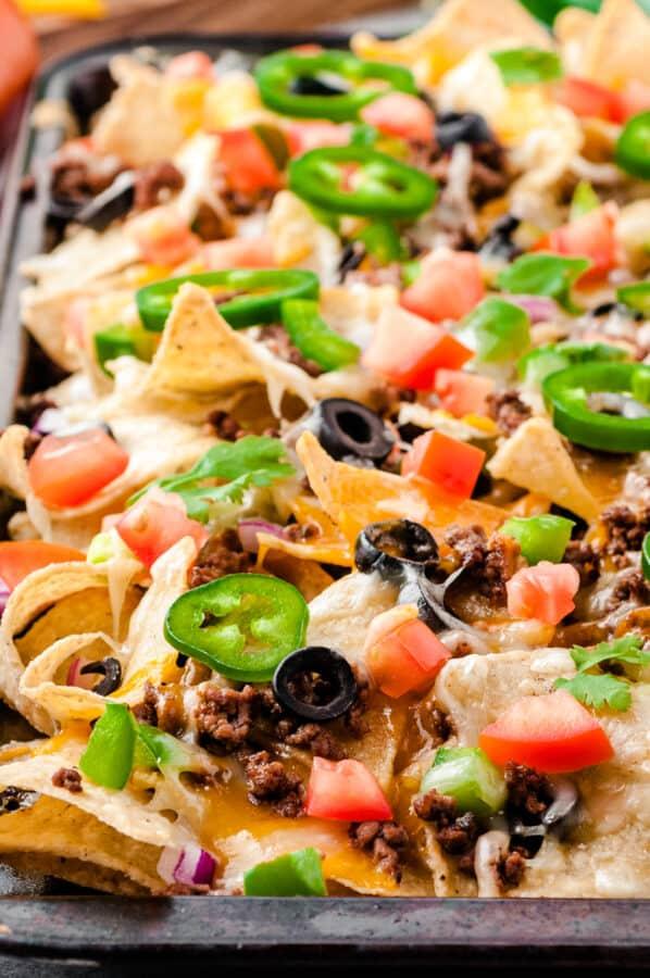 side image of beef nachos on sheet pan