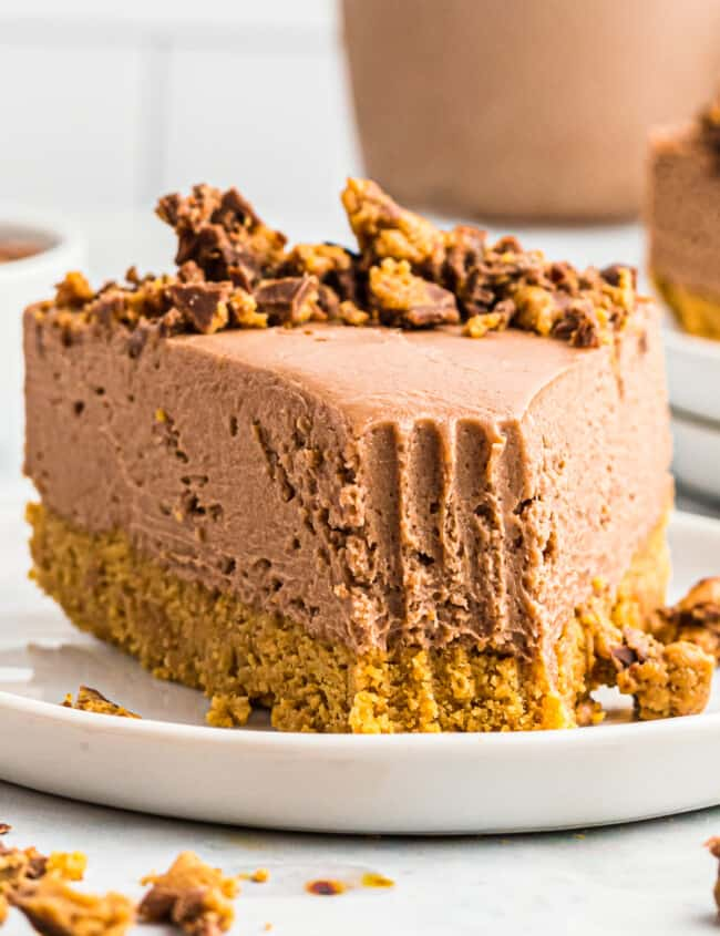 peanut butter cup no bake cheesecake on plate