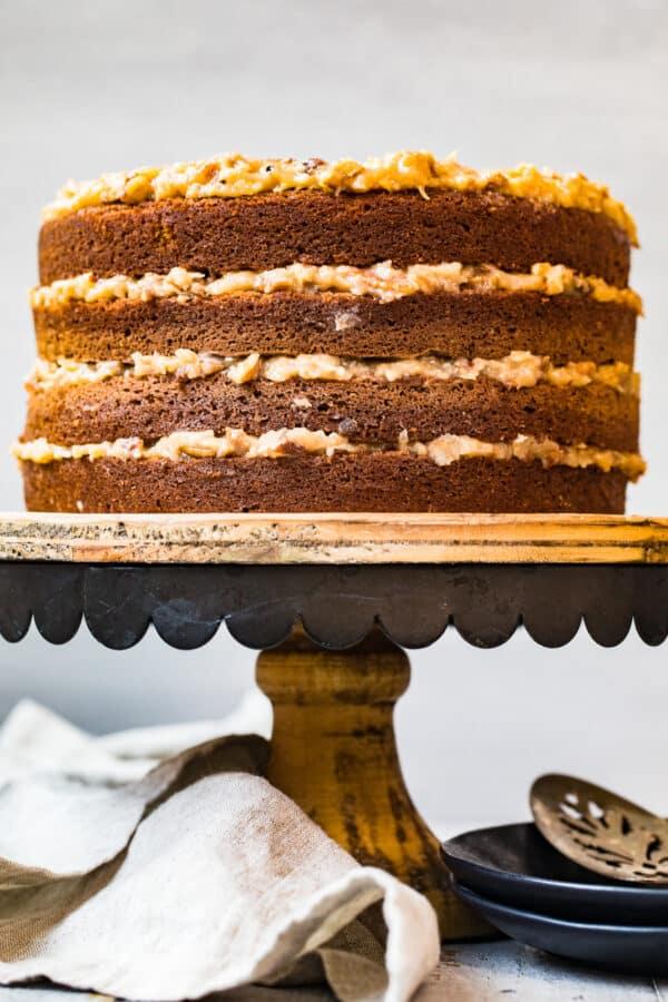layered german chocolate cake on cake stand