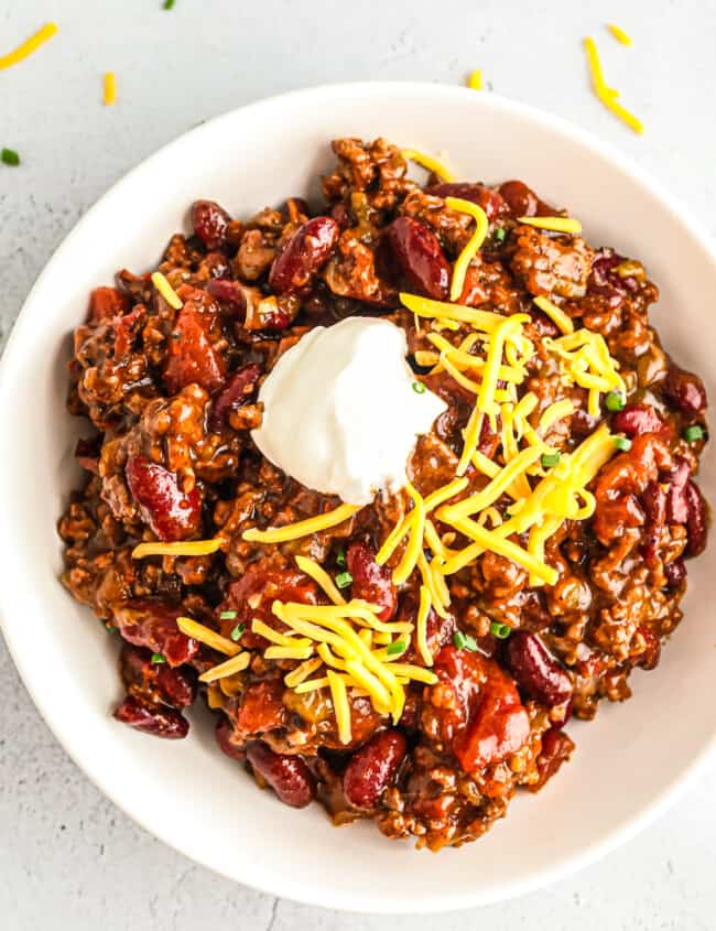 instant pot chili in bowl with cheese and sour cream