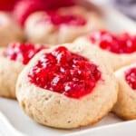 up close image of raspberry jam thumbprint cookies