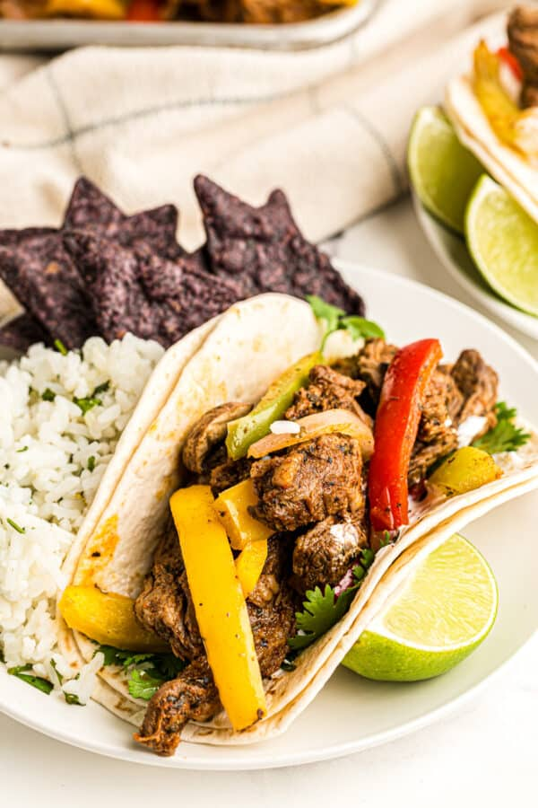 steak fajita on plate with rice
